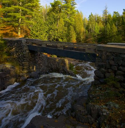 amity: A footbridge over a waterfall on Amity creek in Duluth, Minnesota Stock Photo