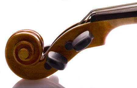 violin scroll, peg box, and tuning pegs in a close up image.