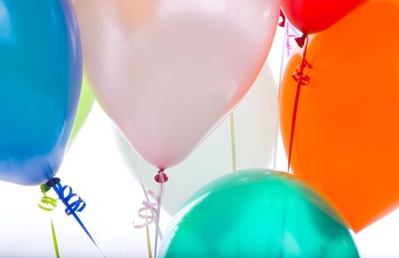 Ballons in a detail image of seven with prominent strings
