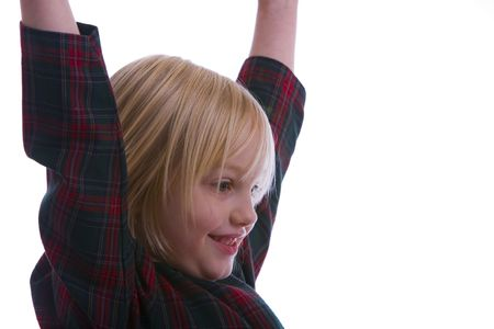 Child victorious and raising her arms