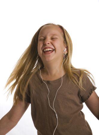 dance preteen: Girl dancing and jamming wearing earbud headphones