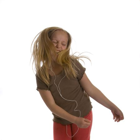 dance preteen: Girl jamming  and dancing while wearing earbuds Stock Photo