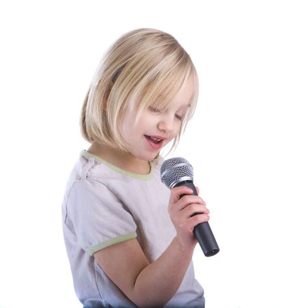 child singing: Child singing into microphone isolated on white background