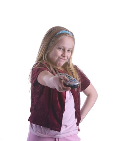 Girl determined to change the channel with her television remote control