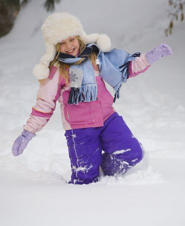 Girl wading through deep snow after a blizzard in Northern Minnesota Imagens
