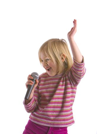 A child wannabe pop idol with microphone Imagens