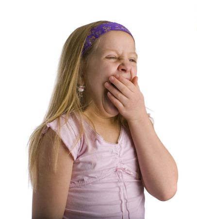 drained: Girl yawning from being tired and exhausted over white