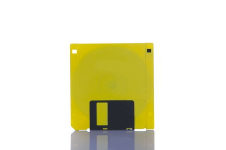 Yellow Floppy Disc ( 3.5 inch High Density ) on a white background