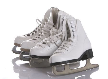 Four figures skates on white and ice background