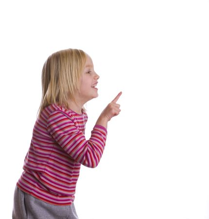 Child pointing to copy space on a white background