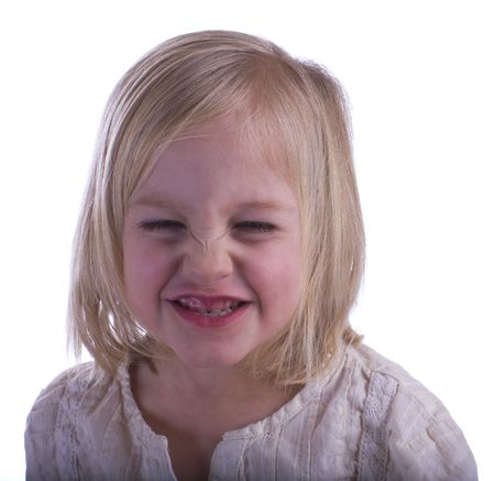 Angry child on a white background