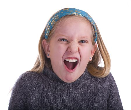 wail: Girl furious in a gray sweater on a white background