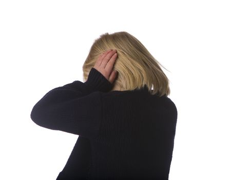 asperger: Child turning away and covering ears dressed in black on a white background Stock Photo