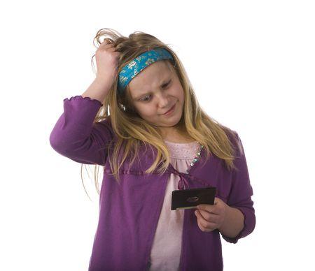 Jeune fille confondu par une vieille disquette Banque d'images - 4208596