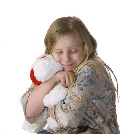 Girl hugging stuffed animal on white background photo