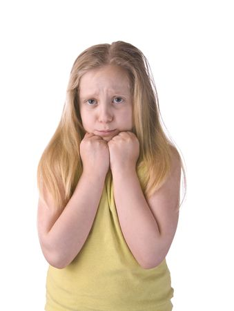 glum: Girl sad and scared hands on chin isolated on a white background Stock Photo