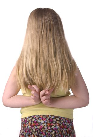 deceit: Girl With Fingers Crossed Behind Back Isolated on a White Background Stock Photo
