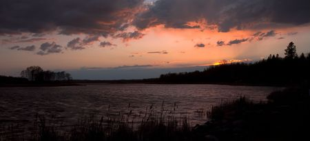 Weather over Wild Race Lake at sunset in Northern Minnesota Imagens