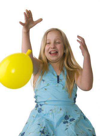 Girl letting go of a balloon on a white background
