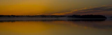 Golden misty Minnesota sunrise on Island Lake North of Duluth, Minnesota