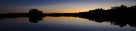 Minnesota sunset silhouette on Island Lake North of Duluth, Minnesota