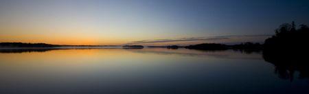 Awaiting dawn at island lake in Northern Minnesota Stock Photo