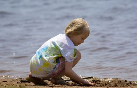 Child playing at the beach on Barkers Island, Wisconsin in Lake Superior Stock Photo