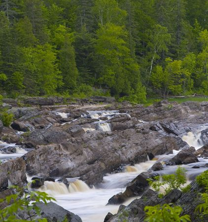 Forest, stone, and rushing water in channels along the St. Louis river in Northern Minnesota Stock Photo