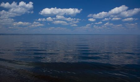 Clouds over the water of Lake Superior from Wisconsin Point looking across at Duluth, Minnesota