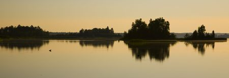 Warm reflection on a summer morning of Boulder Lake Minnesota