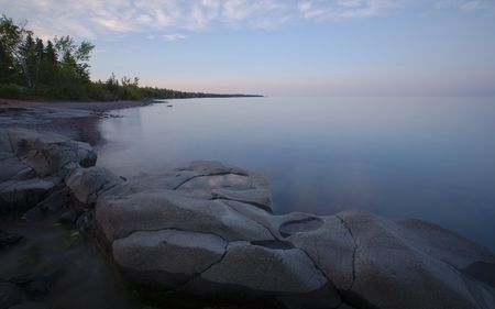 Stoney Point Pensieve - clouds reflecting in a small rock on the North Shore of Lake Superior in Minnesota