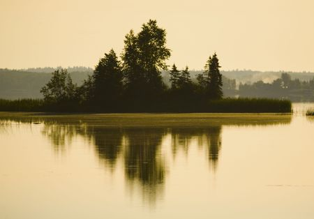 Trees in water and sunlight in Boulder Lake Minnesota Stock Photo