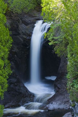 Cascade Falls framed by Green in Northern Minnesota Stock Photo