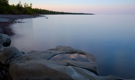 Bowl of clouds in a stone on the North Shore of Lake Superior at Stoney Point in Minnesota Stock Photo