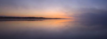 envelop: Clouds envelop Island Lake in Northern Minnesota