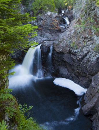Three cascades into pools along the Cascade River in Northern Minnesota Stock Photo
