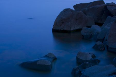 Night, water, and stone on the North Shore of Lake Superior Stock Photo