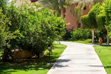 hurghada: Pathway among tropical plants and houses. Hurghada. Egypt. Africa.