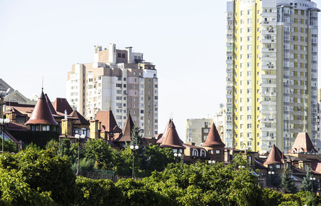 turrets: Villas with turrets against the backdrop of high-rise buildings.