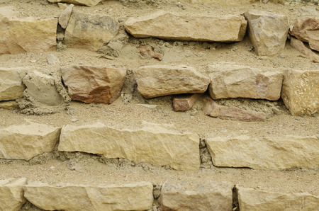 bonded: The texture of multicolored bricks bonded with cement. Stock Photo