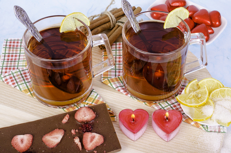 tea candles: Tea candles in heart-shaped cinnamon sticks. On wooden background.