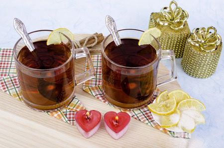 tea candles: Tea candles in the form of hearts and gifts. On wooden background. Stock Photo