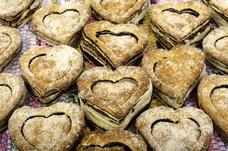 matting: Cookies in shape of  heart on multi-colored matting.