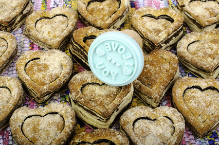 matting: Cookies in the shape of heart on multi-colored matting. And culinary stamp.