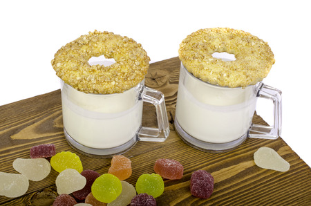 milk and cookies: Two glasses milk, cookies and fruit candy on wooden background. Stock Photo