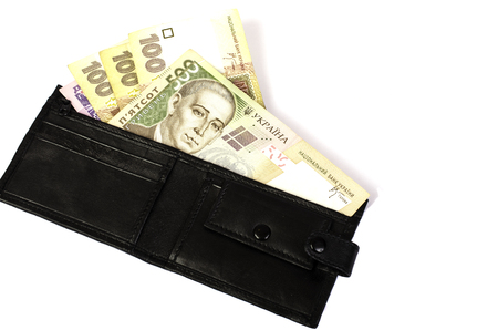 Ukrainian hryvnia. Banknotes in denominations 100, 200, 500 in black purse. Isolated.