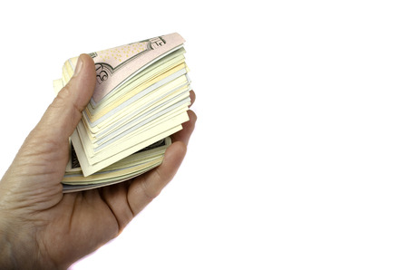money roll: Money roll in hand on a white background. Isolated.