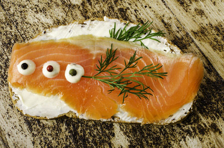 salted: Sandwich with salted salmon. Close-up. Stock Photo