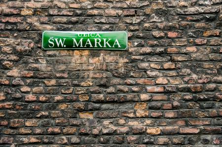 st mark: Plate with name of  street of St. Mark. Krakow. Poland. Spring 2016.