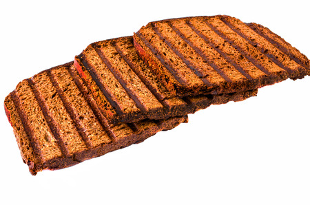 black bread: Three delicious toast of black bread. Isolated. Stock Photo